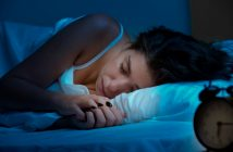 Woman sleeping shutterstock_229267837